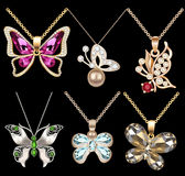 Of a set of butterfly pendants with precious stone. Illustration of a set of butterfly pendants with precious stones Royalty Free Stock Image