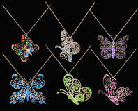 Set of butterfly pendants with precious stones Royalty Free Stock Image