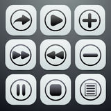 Set of buttons in white with black icons on them o Stock Photography