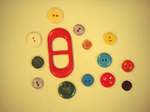 Set of buttons on yellow fabric suitable as background. Royalty Free Stock Image
