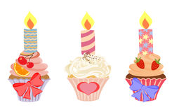 Set of cakes with birthday candles. Royalty Free Stock Images
