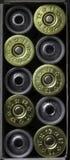 Set of 12 caliber shotgun bullet shells in cardboard box. . Stock Image