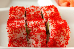 Set California rolls stacked in a disposable container. Stock Images