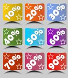 Set of cambered paper labels with percent in different colors with stars and shadow.  Royalty Free Stock Photography
