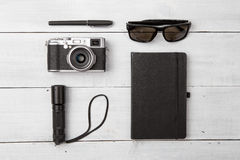 Set of camera and cool travel stuff on wooden table Stock Images