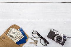 Set of camera and cool travel stuff on wooden table Royalty Free Stock Image