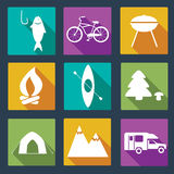 Set of camping icons. Outdoor activity simbols drawn in detailes in vector. Tent, trailer, camper, sleeping bag, fire, grill, mountain, forest, bear, fish Royalty Free Stock Image