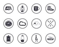 Set of 12 camping silhouette icons and symbols. Hiking equipment elements - tent, boot, lantern, compass. Stock vector. Adventure emblems isolated. Good for T royalty free illustration