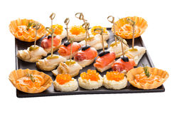 Set canapes with different fish and caviar Stock Photos