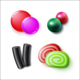 Set of candies. Vector set of different pink, green, red, black sweets, candies, bonbons and marmalades close up top view isolated on white background Stock Photos