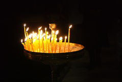 Set of Candles in the dark of a church Royalty Free Stock Photo