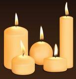 Set of candles at dark. Royalty Free Stock Photos