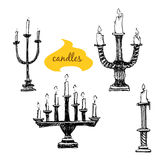 Set of candlesticks with candles Royalty Free Stock Images