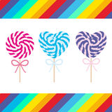 Set candy lollipops with bow, colorful spiral candy cane. Candy on stick with twisted design on white background with bright rainb Stock Photo