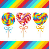 Set candy lollipops with bow, colorful spiral candy cane. Candy on stick with twisted design on white background with bright rainb Stock Photos
