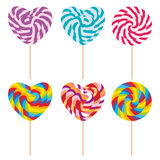 Set candy lollipops, colorful spiral candy cane. Candy on stick with twisted design on white background. Vector Royalty Free Stock Photo