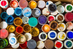 Set of cans of paint. Close up of pile of used cans of gouache paint stock image