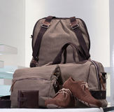 Set of canvas bags and leather men shoes Stock Image