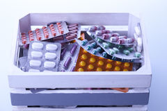 Set of capsules in medical light. Royalty Free Stock Photo