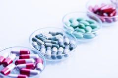 Set of capsules on white background Stock Photos
