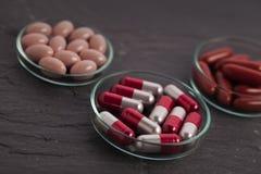 Set of capsules on white background Royalty Free Stock Photo