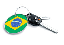 Set of car keys with keyring and country flag. Concept for car p. Rices, buyer or selling a vehicle in country Brazil. Concept for vehicle manufacturers or stock illustration