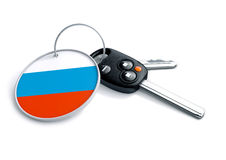 Set of car keys with keyring and country flag. Concept for car p. Rices, buyer or selling a vehicle in Russia. Vehicles made and produced in Russia. Russian stock image