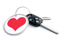 Set of car keys with keyring and red heart icon. Concept for how Royalty Free Stock Image