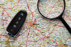 Set of car keys and magnify over a map. Travel concept Royalty Free Stock Photography