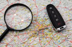 Set of car keys and magnify over a map. Travel concept Stock Photos