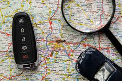 Set of car keys and magnify over a map. Travel concept Royalty Free Stock Image