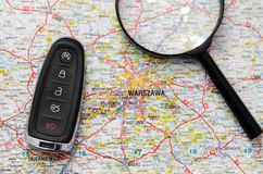 Set of car keys and magnify over a map. Travel concept Stock Photo
