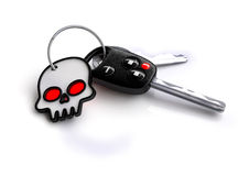 Set of car keys with white skull symbol for a keyring. Set of car keys with a white skull for a keyring. Isolated on white. Concept for road safety and how vector illustration
