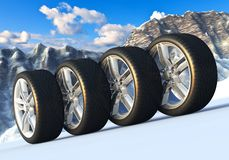 Set of car wheels in snowy mountains Royalty Free Stock Photos