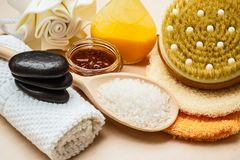 Set for care of skin body, bath accessories. Beauty relaxation and body care. Closeup spa products some bath accessories on wooden table Royalty Free Stock Photography