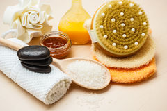 Set for care of skin body, bath accessories. Beauty relaxation and body care. Closeup spa products some bath accessories on wooden table Royalty Free Stock Image
