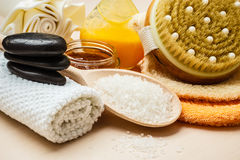 Set for care of skin body, bath accessories. Beauty relaxation and body care. Closeup spa products some bath accessories on wooden table Stock Photos