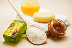 Set for care of skin body, bath accessories. Beauty treatment therapy and skin care. Closeup spa products some bath accessories on wooden table Royalty Free Stock Photography