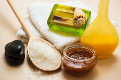 Set for care of skin body, bath accessories. Beauty treatment therapy and skin care. Closeup spa products some bath accessories on wooden table Royalty Free Stock Photo