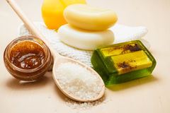 Set for care of skin body, bath accessories. Beauty treatment therapy and skin care. Closeup spa products some bath accessories on wooden table Royalty Free Stock Image