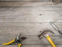 Set of carpenter tools on wooden background frame Stock Image