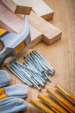 Set of carpentry tools on wooden board Royalty Free Stock Images
