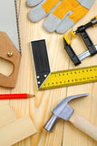 Set of carpentry tools on wooden planks Stock Photo