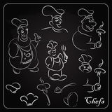 Set cartoon chefs on the blackboard. Cartoons for the menu. Royalty Free Stock Photography