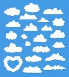 Set of cartoon clouds on blue. vector stock photo