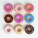 Set of cartoon colorful donuts isolated on white background. Top View Doughnuts collection into glaze for menu design