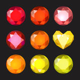 Set of cartoon different color crystals, gemstones, gems, diamonds vector. Vector image on black background. Royalty Free Stock Image