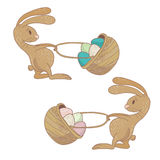 Set of cartoon easter rabbits. Pulling basket with colored eggs. Vactor eps10 Royalty Free Stock Photo