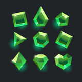 Set of cartoon green different shapes crystals. Gemstones,gems,diamonds vector gui assets collection for game design.isolated vector elements.Gui elements Stock Images
