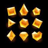 Set of cartoon orange different shapes crystals. Gemstones,gems,diamonds vector gui assets collection for game design.isolated vector elements.Gui elements Stock Images